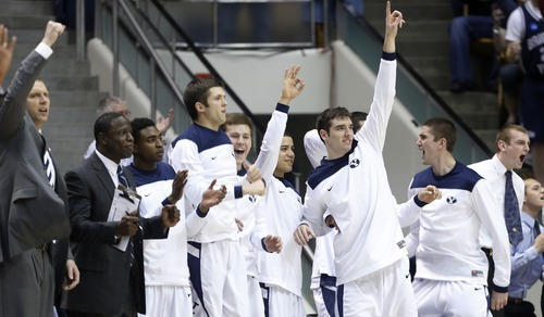 Steve Griffin | The Salt Lake Tribune   The BYU bench celebrates a three pointer as BYU pulls away from Washington late in the second half in the first round of the NIT at the Marriott Center  Provo, Utah Tuesday March 19, 2013.