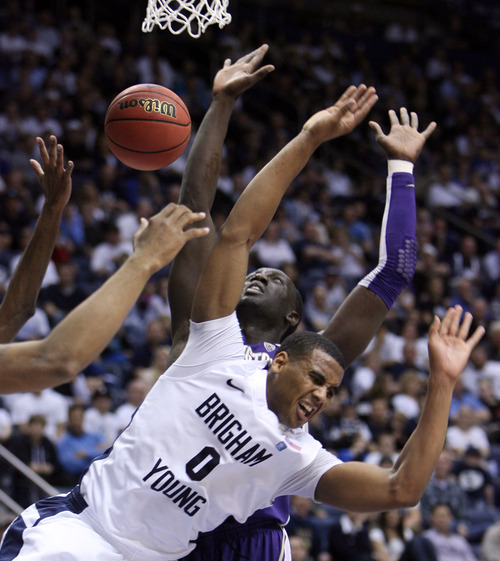 Steve Griffin | The Salt Lake Tribune   BYU's Brandon Davies gets fouled by Washington's Aziz N'Diaye during first half action in the first round of the NIT at the Marriott Center  Provo, Utah Tuesday March 19, 2013.