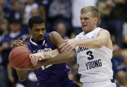 Steve Griffin | The Salt Lake Tribune   BYU's Tyler Haws, right, battles Washington's Scott Suggs for a the ball during second half action in the first round of the NIT at the Marriott Center  Provo, Utah Tuesday March 19, 2013.