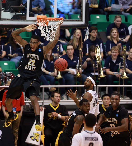 Scott Sommerdorf  |  The Salt Lake Tribune  Wichita State Shockers forward Carl Hall (22) gets a huge dunk as the Panthers face the Shockers in the NCAA tournament at EnergySolutions Arena on Thursday, March 21, 2013.