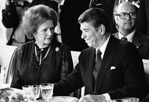 FILE - This is a  Sunday, June 6, 1982 file photo of U.S. President Ronald Reagan and Britain's Prime Minister Margaret Thatcher at the lunch table, Sunday, June 6, 1982 at the Palace of Versailles, France, following the first session of the second days summit meeting.  Margaret Thatcher felt betrayed by close ally Ronald Reagan over the Falkland Islands, according to newly released papers that reveal how isolated Britain's prime minister was in her determination to repel the Argentine invasion by force. When Argentina seized the British territory off the South American coast in April 1982, Thatcher's government presented a united front in public.(AP Photo/ File)