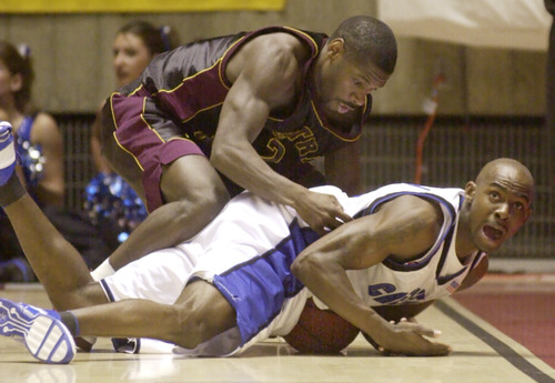 Creighton's DeAnthony Bowden, bottom, looks to the referee as Central Michigan's J.R. Walla tries to get to the ball during the first half of their NCAA West Regional game Thursday, March 20, 2003, in Salt Lake City. (AP Photo/Douglas C. Pizac)