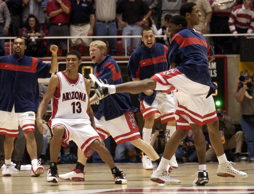 Arizona celebrates victory. Arizona wins in double overtime 96-95. Arizona vs. Gonzaga, 2nd round NCAA Basketball Tournament. Photo by Trent Nelson; 03.22.2003, 6:28:31 PM