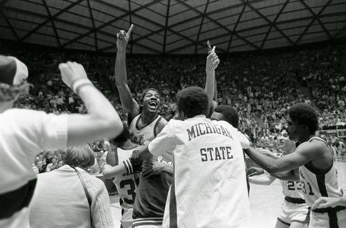 Michigan State's Earvin (Magic) Johnson raises his finger to indicate the Spartans are number one after defeating Larry Bird's Indiana State team 75-64 to win the NCAA Championship in Salt Lake City, March 26, 1979. (AP Photo)