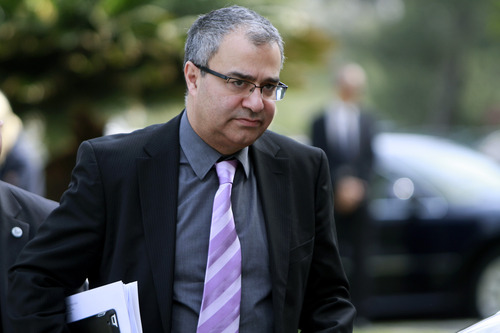 Cyprus' Central Bank chief Panicos Demetriades arrives at the presidential palace in capital Nicosia, Thursday, March 21, 2013. The European Central Bank says it will keep emergency aid for Cyprus' troubled banks in place at least until Monday but will have to cut it off after that unless an international rescue program is drawn up. (AP Photo/Petros Karadjias)