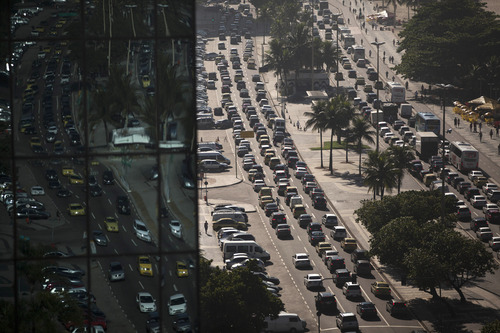 FILE - In this Thursday, May 10, 2012, file photo, drivers navigate in a congestion of traffic at Copacabana in Rio de Janeiro, Brazil. In 2011, the U.S. became a net exporter of fuels for the first time in 60 years. Mexico and Canada are the two biggest destinations for U.S. fuels, followed by Brazil and the Netherlands. (AP Photo/Felipe Dana, File)