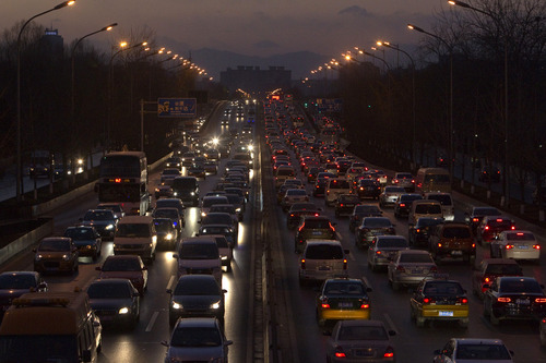 FILE - In this Tuesday, Dec. 14, 2010, file photo, vehicles pack a main road during rush hour in Beijing. China, which overtook the U.S. late last year as the world's largest oil importer, has the single biggest influence on global demand for fuels. China's consumption has risen 28 percent in five years, to 10.2 million barrels per day last year.  (AP Photo/Alexander F. Yuan)