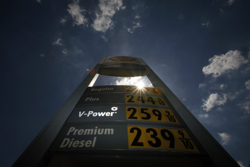 FILE- In this Thursday, May 21, 2009, file photo, Gas pries are shown on a sign at a gas station, in Grand Prairie, Texas. U.S. oil output rose 14 percent to 6.5 million barrels per day in 2012,  a record increase, but you'd never know it from the price at the pump. The national average price of gasoline is $3.69 per gallon and it is forecast to creep higher and could approach $4 by May.  (AP Photo/Matt Slocum, File)