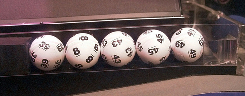 The balls drawn Wednesday, July 29, 1998, in the $292 million Powerball lottery rest in a hopper in West Des Moines, Iowa. Numbers drawn at the 10:59 p.m. EDT drawing were 8, 39, 43, 45, and 49, with a Powerball 13. The ticket sales reached 204.4 million for the drawing.  (AP Photo/Steve Pope)