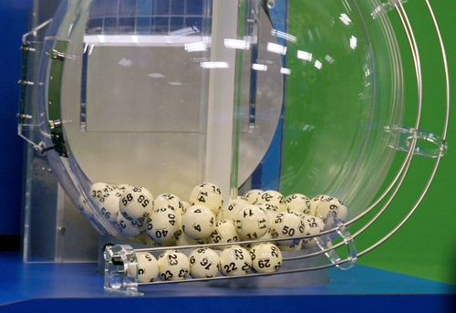 Powerball numbers are chosen in the drawing at the Florida Lottery on Wednesday, Nov. 28, 2012, in Tallahassee, Fla. The numbers drawn in the $579.9-million game were: 5, 16, 22, 23, 29 and Powerball of 6. (AP Photo/Phil Sears)