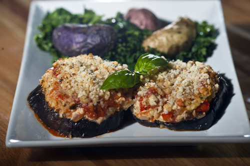 Chris Detrick  |  The Salt Lake Tribune Eggplant parmesan with cashew cheese, roasted fingerling potatoes and kale ($13) at Zest Kitchen & Bar in Salt Lake City.