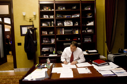 Kim Raff  |  The Salt Lake Tribune Gov. Gary Herbert works in his office as the Senate and House work on the remaining legislation during the final hours of the Utah legislative session at the Utah State Capitol in Salt Lake City on March 14, 2013.