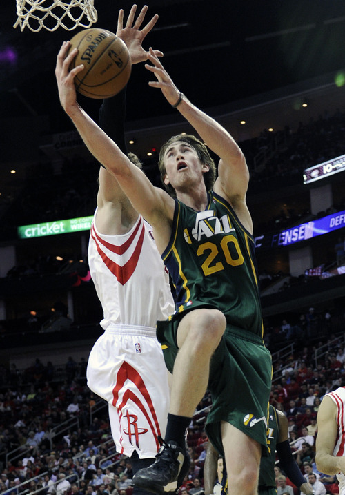 Utah Jazz's Gordon Hayward (20) shoots for two points in front of Houston Rockets' Omer Asik in the second half of an NBA basketball game on Wednesday, March 20, 2013, in Houston. The Rockets won 100-93. (AP Photo/Pat Sullivan)
