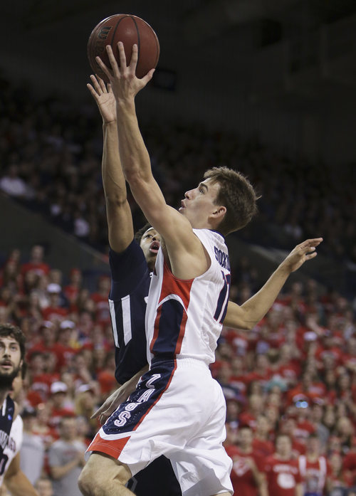 Gonzaga's David Stockton, front, attempts a layup against San Diego's Christopher Anderson during the first half of an NCAA basketball game in Spokane, Wash., on Saturday, Feb. 23, 2013. (AP Photo/Young Kwak)