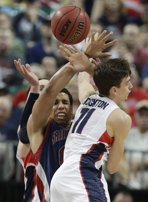 Gonzaga's David Stockton (11) blocks a pass by Saint Mary's Brad Waldow during the second half of the West Coast Conference tournament championship NCAA college basketball game, Monday, March 11, 2013, in Las Vegas. Gonzaga won 65-51. (AP Photo/Julie Jacobson)