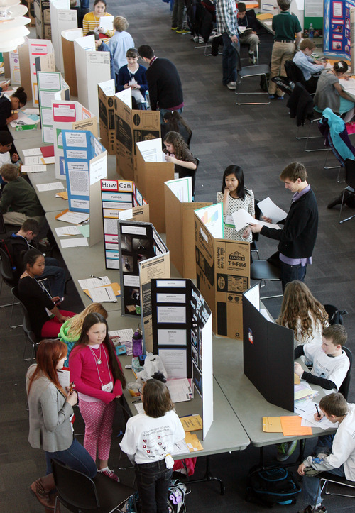 Steve Griffin  |  The Salt Lake Tribune Elementary school students get their projects judged at the Salt Lake Valley Science and Engineering Fair, held Thursday at the University of Utah's Rice-Eccles Stadium.