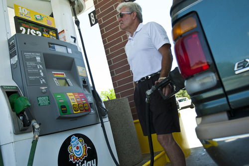 Chris Detrick  |  Tribune file photo Garry Pennington, of Kamas, fills up his vehicle with gas at Holiday gas station in Riverton last summer. A new study says Utah needs to explore new revenues to raise billions to pay for the state's transportation and transit systems.