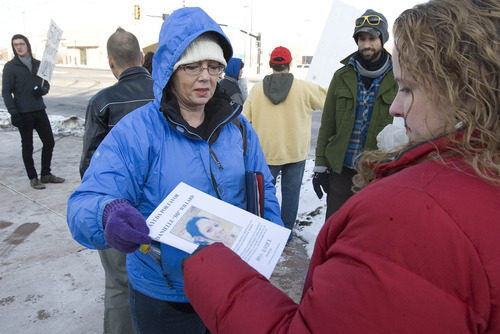 Paul Fraughton      Salt Lake Tribune Melissa Kennedy,mother of Danielle Willard, who was shot and killed by West Valley Police, hands out a flyer  to Kristie Wozab asking for any witnesses to the shooting to  call with information. A group of  people in support of Danielle, held posters in front of the West Valley City Hall critical of the police department and their handling of the shooting.  Tuesday, January 22, 2013