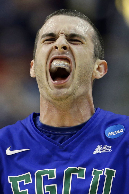 Florida Gulf Coast's Brett Comer reacts after scoring during the first half of a second-round game against Georgetown during the NCAA college basketball tournament on Friday, March 22, 2013, in Philadelphia. (AP Photo/Matt Rourke)