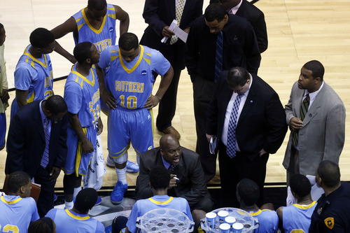 Chris Detrick  |  The Salt Lake Tribune  Southern University Jaguars head coach Roman Banks talks to his team during a time out as the Bulldogs face the Jaguars in the NCAA tournament at EnergySolutions Arena on Thursday, March 21, 2013.