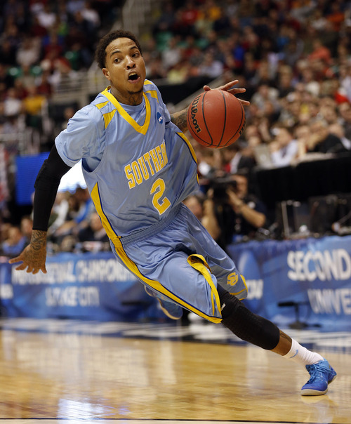 Trent Nelson  |  The Salt Lake Tribune  Southern University Jaguars guard Derick Beltran (2) dribbles down court as the Bulldogs face the Jaguars in the NCAA tournament at EnergySolutions Arena on Thursday, March 21, 2013.