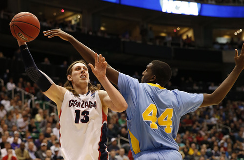 Trent Nelson  |  The Salt Lake Tribune  Gonzaga Bulldogs forward Kelly Olynyk (13) is defended by Southern University Jaguars center Javan Mitchell (44) as the Bulldogs face the Jaguars in the NCAA tournament at EnergySolutions Arena on Thursday, March 21, 2013.