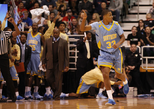 Trent Nelson  |  The Salt Lake Tribune  Southern University Jaguars guard Malcolm Miller (33) reacts after hitting a three pointer as the Bulldogs face the Jaguars in the NCAA tournament at EnergySolutions Arena on Thursday, March 21, 2013.