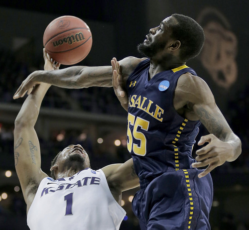 La Salle guard Ramon Galloway (55) tries to block a shot by Kansas State guard Shane Southwell (1) during the second half of a second-round game of the NCAA college basketball tournament Friday, March 22, 2013, in Kansas City, Mo. La Salle won 63-61. (AP Photo/Charlie Riedel)