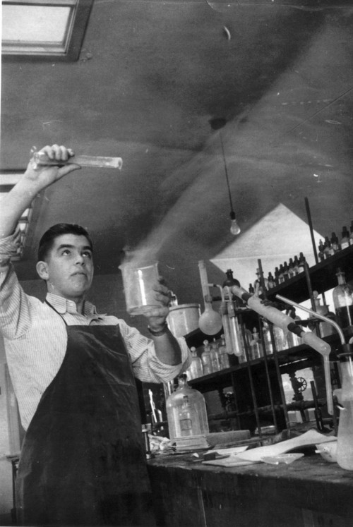 PHOTO  |  Courtesy of University of Utah  Sam Skaggs works in a school lab in the 1940s. He dropped out of Westminster College to serve in Europe during World War II.