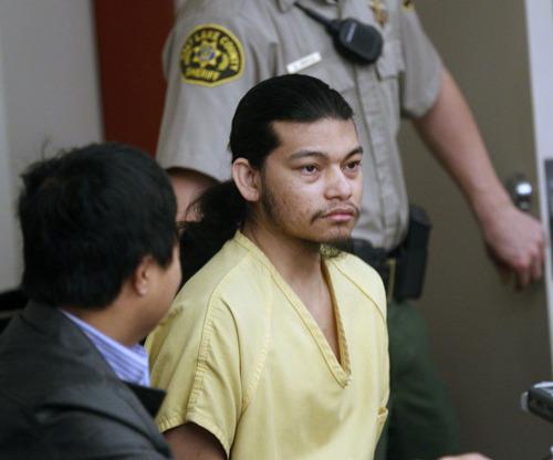 Al Hartmann  |  The Salt Lake Tribune Esar Met, accused of killing 7-year-old Hser Ner Moo in 2008, enters Judge William Barrett's 3rd District Courtroom in Salt Lake City in November for his preliminary hearing.