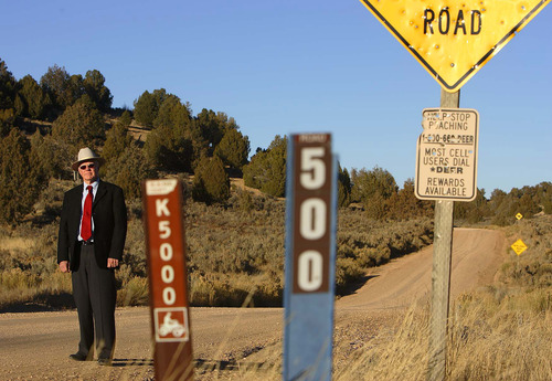 Trent Nelson  |  Tribune file photo Then-Kane County Commissioner Mark Habbeshaw at the intersection of Johnson Canyon Road and Skutumpah Road in the Grand Staircase National Monument in 2005, where the BLM and Kane County had placed conflicting signs. Kane County's sign, left, indicates OHV/ATV access, which the BLM disputes.