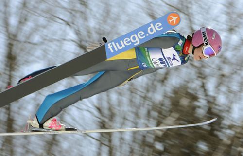 Sarah Hendrickson of the United States soars in the air during the women's ski jumping World Cup meet in Zao, Yamagata Prefecture, northern Japan, Sunday, March 4, 2012. Hendrickson won the event with 249.1 points. (AP Photo/Kyodo News) JAPAN OUT, MANDATORY CREDIT, NO LICENSING IN CHINA, FRANCE, HONG KONG, JAPAN AND SOUTH KOREA
