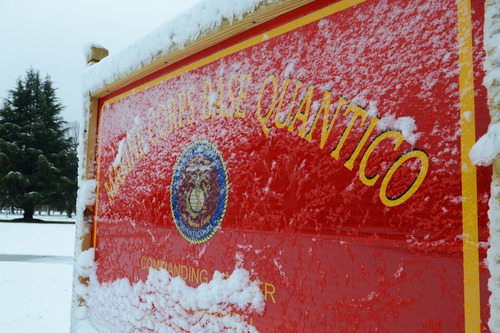This image provided by the U.S. Marine Corps shows snow covering one of Marine Corps Base Quantico's many signs Wednesday March 6, 2013. Three people, including the suspect, were killed in a shooting at Marine Base Quantico, a base spokesman said early Friday March 22, 2013. Lt. Agustin Solivan said they believe the suspect, whose name wasn't released, is a staff member at the officer candidate school at the base. No information on the victim was immediately released. (AP Photo/US Marine Corps, Cpl. Antwaun L. Jefferson)