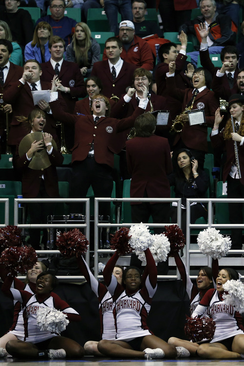Chris Detrick  |  The Salt Lake Tribune Members of the Harvard Crimson band and cheerleaders cheer during the NCAA tournament at EnergySolutions Arena Thursday March 21, 2013.  Harvard won the game 68-62.