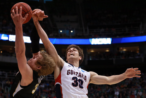 Scott Sommerdorf  |  The Salt Lake Tribune  Gonzaga Bulldogs guard Mike Hart (30) defends Wichita State Shockers guard Ron Baker (31) as the Bulldogs face the Shockers in the NCAA tournament at EnergySolutions Arena on Saturday, March 23, 2013.