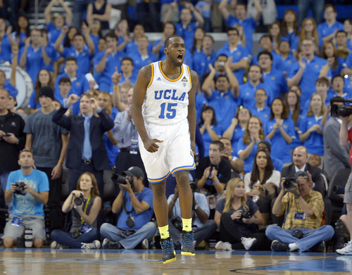 UCLA's Shabazz Muhammad celebrates as time runs out in the second half of an NCAA college basketball game against Arizona, Saturday, March 2, 2013, in Los Angeles. UCLA won 74-69. (AP Photo/Mark J. Terrill)