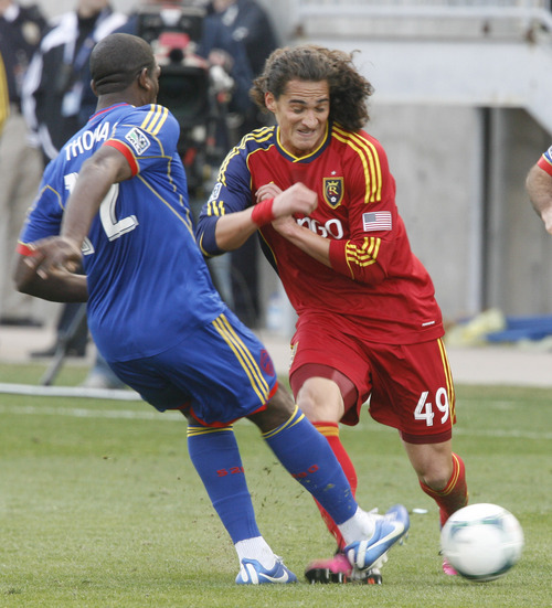 Rick Egan  | The Salt Lake Tribune   Colorado Rapids midfielder Hendry Thomas (12) kicks the ball, as Real Salt Lake forward Devon Sandoval (49) defends, in MLS soccer action, at RIo Tinto Stadium, Saturday, March 16, 2013.