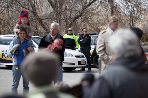 Lennie Mahler  |  The Salt Lake Tribune Police watch as protesters gather at the Chevron oil refinery north of downtown Salt Lake City, voicing concerns about damage to the environment, wildlife, and public health. Saturday, March 23, 2013.