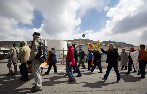 Lennie Mahler  |  The Salt Lake Tribune Protesters march to the gate of the Chevron oil refinery in Salt Lake City in opposition to oil extraction from tar sands citing damage to the environment, wildlife, and public health. Saturday, March 23, 2013.