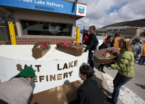 Lennie Mahler  |  The Salt Lake Tribune Protesters place cardboard coffins at the gate of the Chevron oil refinery in Salt Lake City demanding an end to oil extraction from tar sands, citing damage to the environment, wildlife, and public health. Saturday, March 23, 2013.