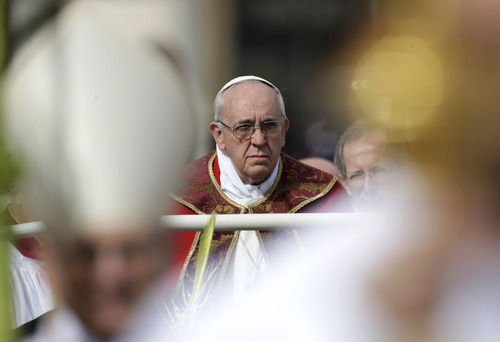 Pope Francis arrives to celebrate Palm Sunday mass, in St. Peter's Square, at the Vatican, Sunday, March 24, 2013. (AP Photo/Andrew Medichini)