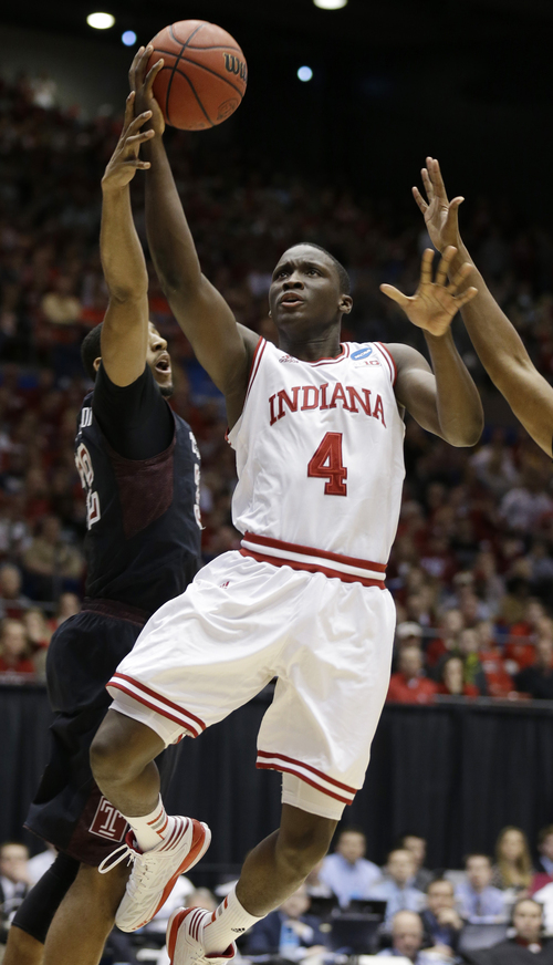 Indiana guard Victor Oladipo (4) drives past Temple forward Rahlir Hollis-Jefferson in the first half of a third-round game of the NCAA college basketball tournament on Sunday, March 24, 2013, in Dayton, Ohio. (AP Photo/Al Behrman)