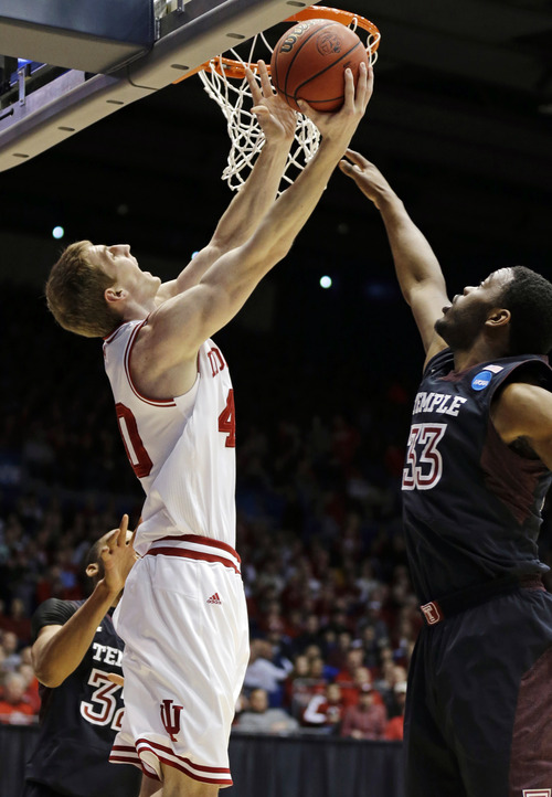 Indiana forward Cody Zeller (40) shoots against Temple guard Scootie Randall (33) in the first half of a third-round game of the NCAA college basketball tournament, Sunday, March 24, 2013, in Dayton, Ohio. (AP Photo/Al Behrman)
