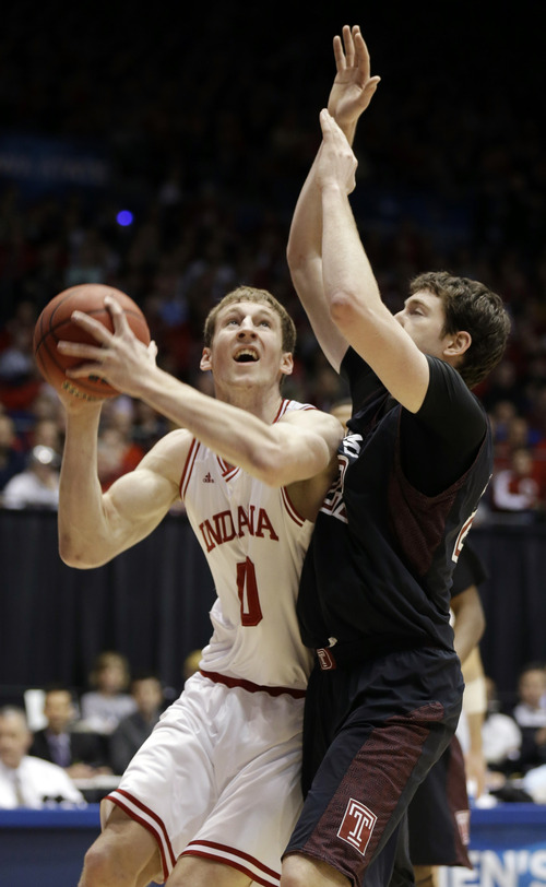 Indiana forward Cody Zeller (40) shoots against Temple forward Jake O'Brien (22) in the first half of a third-round game of the NCAA college basketball tournament, Sunday, March 24, 2013, in Dayton, Ohio. (AP Photo/Al Behrman)