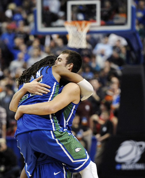 Florida Gulf Coast's Sherwood Brown, left, and Chase Fieler celebrate after winning a third-round game against San Diego State in the NCAA college basketball tournament, Sunday, March 24, 2013, in Philadelphia. Florida Gulf Coast became the first No. 15 seed in NCAA history to reach the regional semifinals with their 81-71 victory over San Diego State. (AP Photo/Michael Perez)