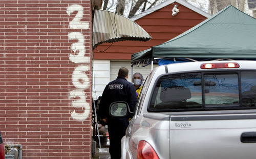 Kim Raff  |  The Salt Lake Tribune Police investigate a shooting at a home at 2363 South Redwood Road in West Valley City on March 11, 2013.