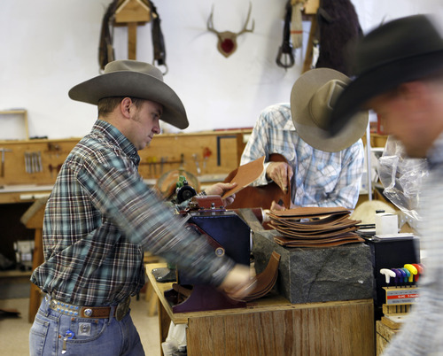 Al Hartmann  |  The Salt Lake Tribune Saddle maker Justin Miller works on a leather splitter to make exact-fitting pieces at Burns Saddlery shop in Salina.