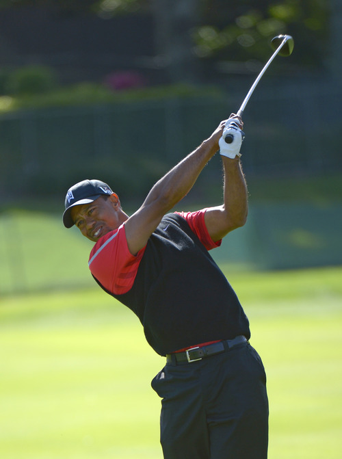 Tiger Woods hits a shot from the fourth fairway during the final round of the Arnold Palmer Invitational golf tournament, Monday, March 25, 2013, in Orlando, Fla. (AP Photo/Phelan M. Ebenhack)