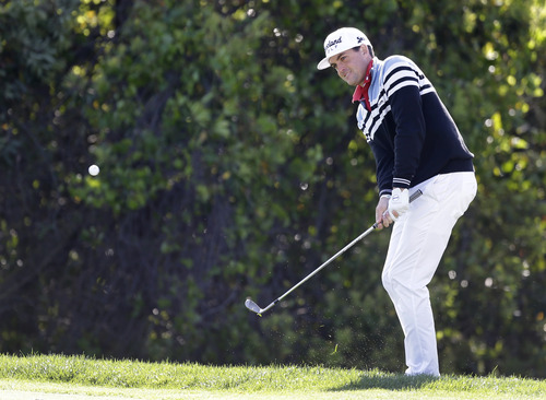Keegan Bradley hits chip shot to the sixth hole during the final round of the Arnold Palmer Invitational golf tournament, Monday, March 25, 2013, in Orlando, Fla. (AP Photo/John Raoux)