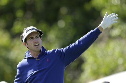 Gonzalo Fenandez Castano, of Spain, waves his left hand after his shot from the seventh tee during the final round of the Arnold Palmer Invitational golf tournament, Monday, March 25, 2013, in Orlando, Fla. (AP Photo/John Raoux)